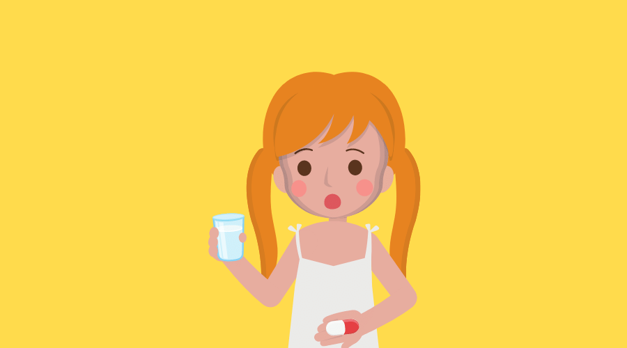 薬を飲もうとしている女の子がいる。