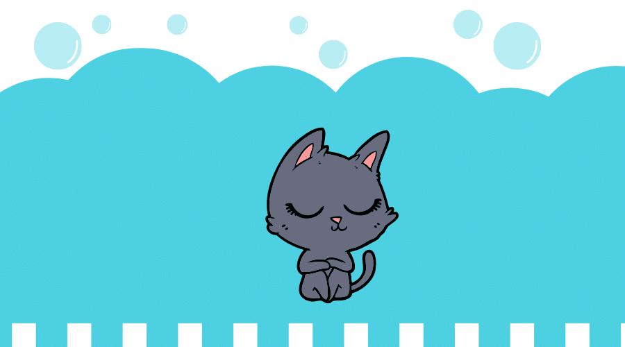 黒猫がひざを抱えて座っている。